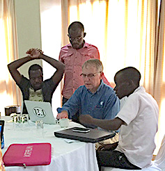 African journalists line up for editing by author David Poulson of SEJ, who traveled to Malawi, Rwanda and Peru last summer to help researchers and journalists explain agricultural issues to the public.
