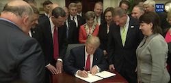 President Donald Trump signing an executive order on the Waters of the United States rule on February 28, 2017. Photo: White House
